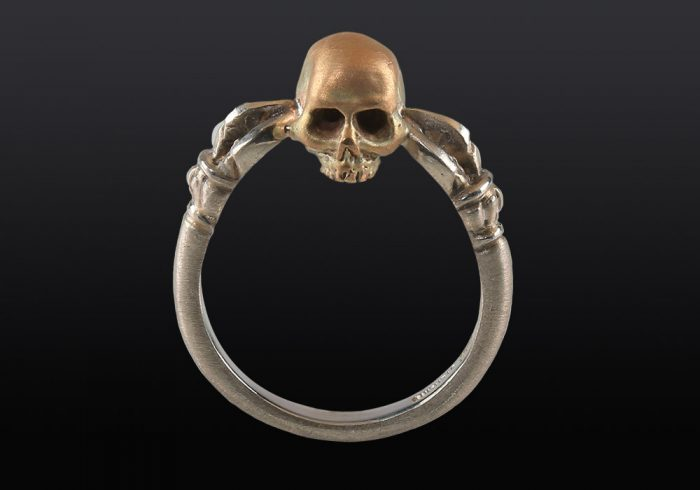 handmade Buddhist skull ring made of silver and gold