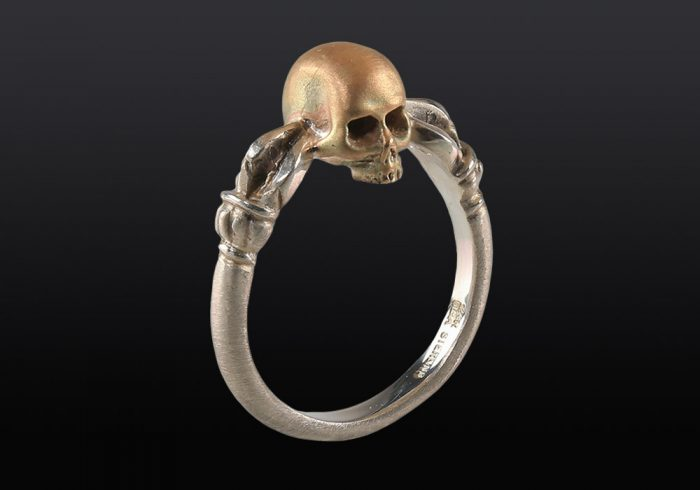 Thunderbolt skull ring made of silver and gold