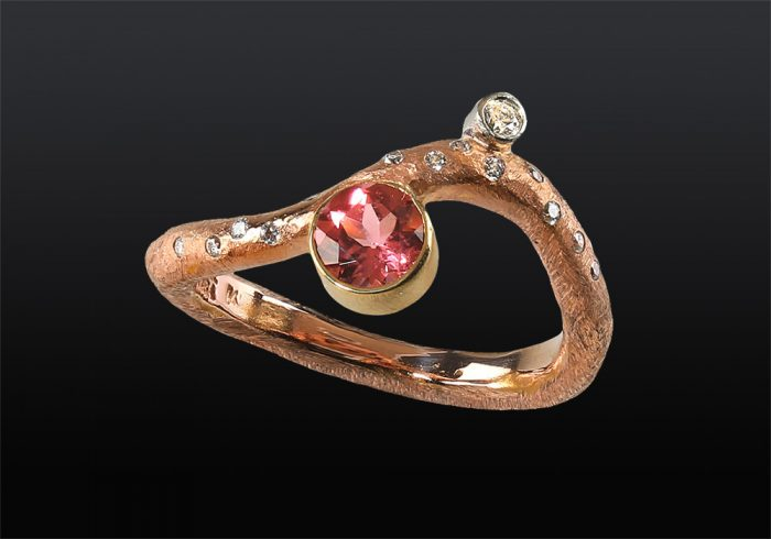 twig ring design made of gold with pink tourmaline gemstone