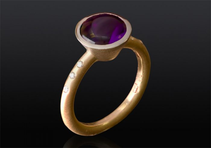 large purple amethyst ring set in yellow gold