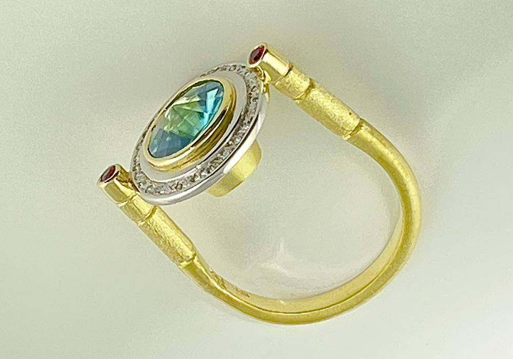 custom gold and platinum gemstone ring in unique setting