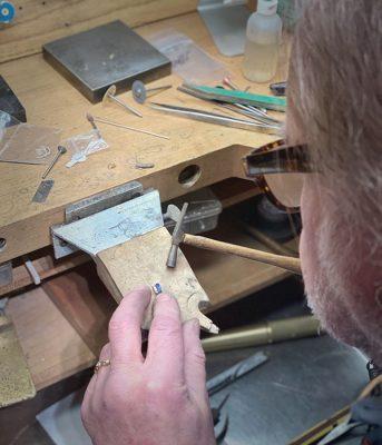 Master goldsmith creating custom jewelry